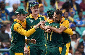 South Africa's Imran Tahir (R) hugs teammate AB de Villiers (2nd R)