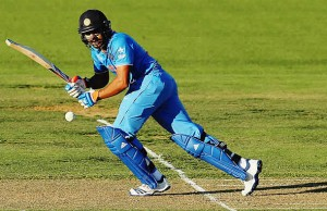 Rohit Sharma of India plays the ball away