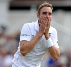 Stuart Broad of England celebrates dismissing Steven Smith of Australia